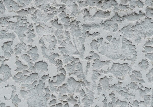 abstract background of textured aged stucco wall